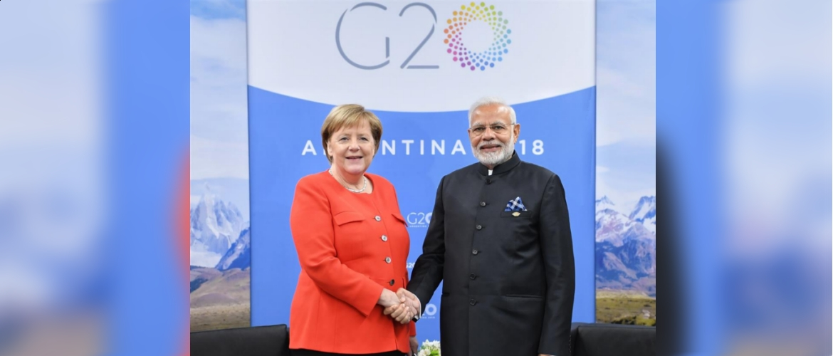 PM Modi and Chancellor Merkel at meet on the sidelines of G20 summit in Buenos Aires, Argentina on December 1, 2018.