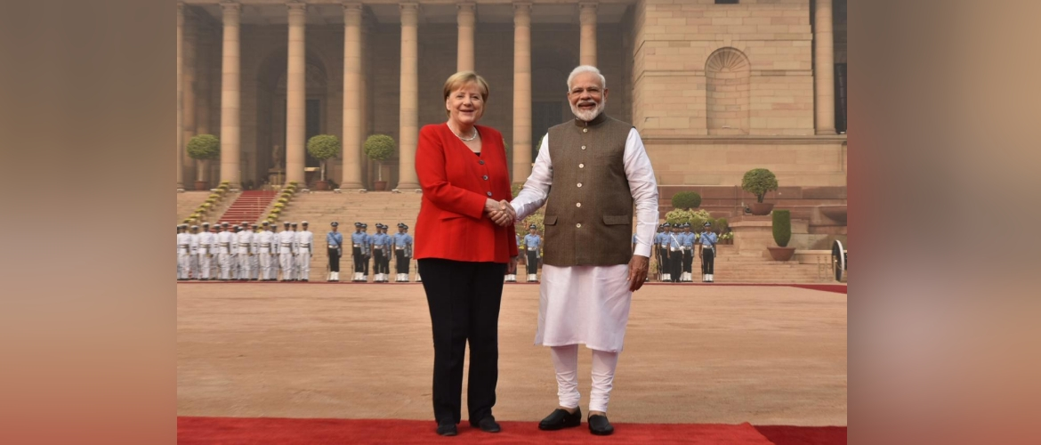 PM Modi greets Chancellor Merkel on her 4th visit to India for a ceremonial welcome at the Rashtrapati Bhawan.